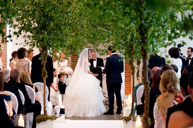 Great Fosters Orangery, Silver birch trees line the aisle - Hayley Bray Photography